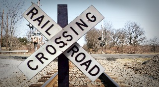 One person transported to hospital following car versus train accident_24521