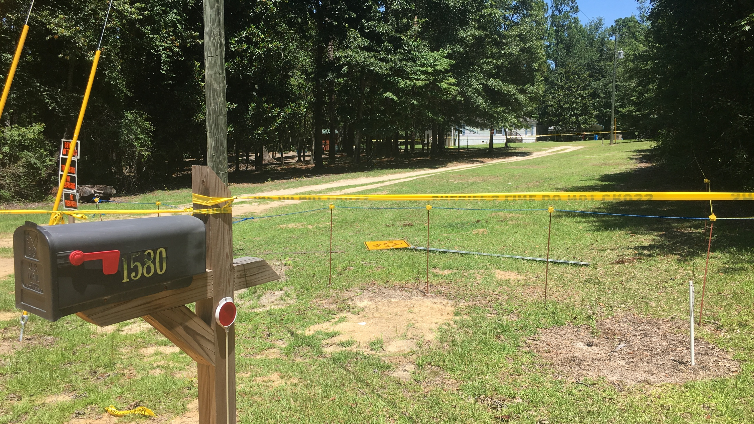 Crime scene tape is still up one day after a Dillon County Sheriff shot and killed James Gerald Davis._377423