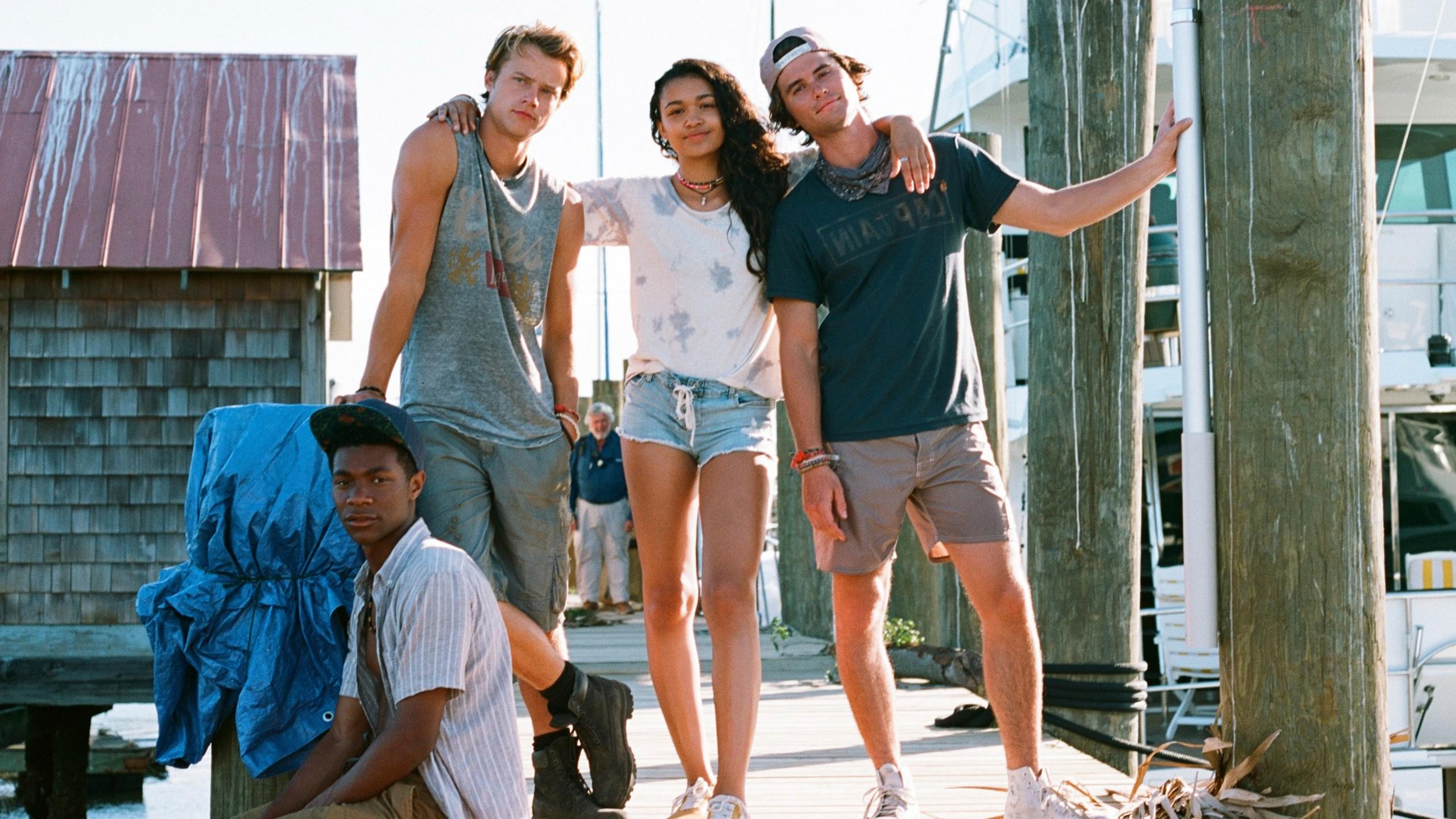 The four main characters of Outer Banks: Pope (Jonathan Davis), JJ (Rudy Pankow), Kiara (Madison Bailey), and John B (Chase Stokes)
