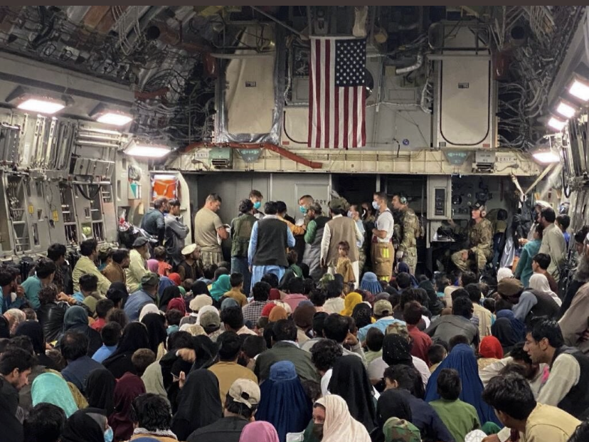 Crewmembers gather around the baby born aboard the Afghan evacuation flight. (USAF courtesy photo)